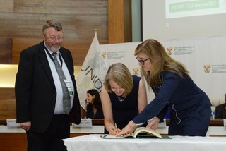 Louise Gullifer signing the Final Act of the Diplomatic Conference
